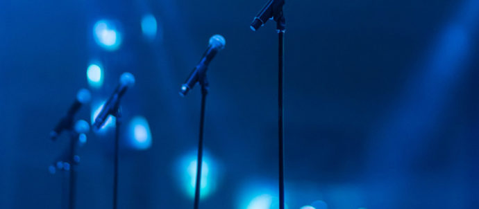 Blue light lit stage with mics